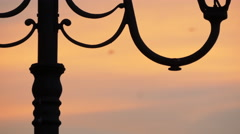 Close up view of a vintage lamp post seen at dusk in Alba Iulia Stock Footage
