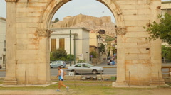 Stock Video Footage of Parthenon on Acropolis seen through Hadrian's Gate, active man on morning run