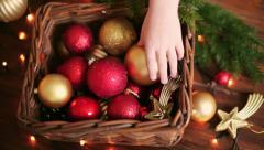 Children's hands plucked Christmas toys in a basket Stock Footage