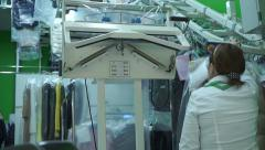 Unrecognizable dry-cleaning operator at work Stock Footage