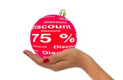 Hand holds 75 percent discount bauble - stock illustration