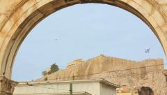 Stock Video Footage of View of Acropolis and Parthenon temple through Hadrian's Arch in Athens, Greece