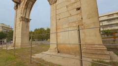 Ancient monumental gate in Athens, Greece. Arch of Hadrian, sightseeing tour Stock Footage