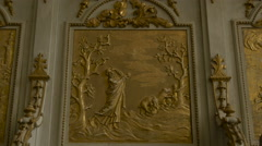 Golden bas-relief inside the Saint Michael cathedral in Alba Iulia - stock footage