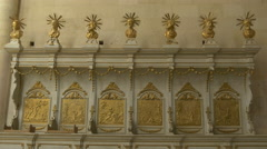 Golden statues and bas-reliefs of saints in the Catholic Cathedral in Alba Iulia Stock Footage