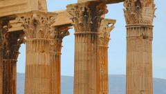 Stock Video Footage of Vertical pan shot of tall marble columns, Corinthian capitals and architraves