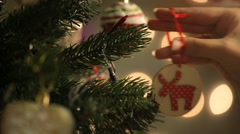 girl hangs on a beautiful Christmas tree toy - stock footage