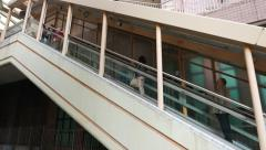Woman travel up on outdoor moving staircase, Mid Levels escalators section Stock Footage