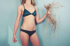 Woman in bikini with weed - stock photo