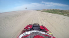 First person POV of a four wheeler driving on trails at the coast Stock Footage