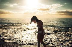 Woman wading in sea Stock Photos