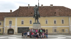 Group of people in front of Michael the Brave statue in Alba Iulia Stock Footage