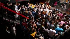 Crowd spectators listening to music concert in flash spot light lumiere - stock footage