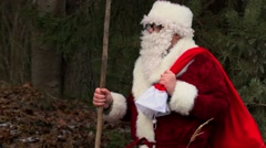 Santa Clause with ice cold hands in forest - stock footage