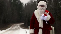 Santa Clause try to stop car on the bridge - stock footage