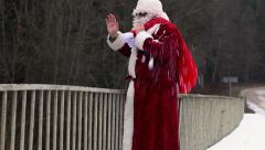 Santa Claus waving hand on the bridge - stock footage