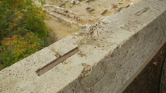 Top view of archaeology excavations site, remains of stone building foundation - stock footage
