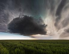 USA, Nebraska, View of supercell cloud over field Stock Photos