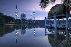 Malaysia, Shah Alam, Sunrise at Masjid Sultan Salahuddin Abdul Aziz Shah mosque Stock Photos