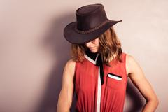 Young woman wearing red dress and cowboy hat Stock Photos