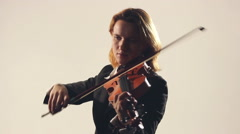 Woman playing on violin on white backgraund Stock Footage