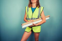 Sexy female engineer with plans - stock photo