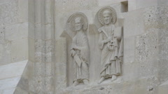 Sculpture of two saints on the wall of a building from Alba Iulia fortress - stock footage