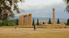Tourists studying map to find the right way in territory of Olympian Zeus Temple Stock Footage
