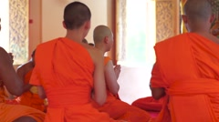 Monks praying in the temple in the ordain ritual, Thailand Stock Footage