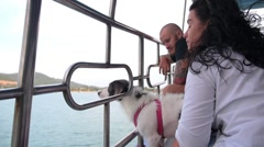Young Stylish Couple with Dog in Sea Stock Footage