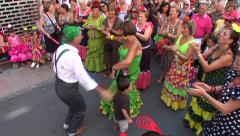 People dancing in flamenco style dress and getting fun at the Malaga Fair Stock Footage