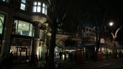 London crowd in the night: Sicilian Avenue in the night, London, England Stock Footage