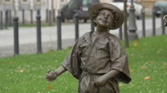Bronze statue of a boy holding an apple in Alba Iulia fortress - stock footage