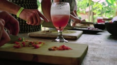 Cutting red chili pepper in a balinese cooking class Stock Footage