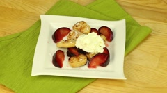 Dessert with plums, ice cream and cookies Stock Footage