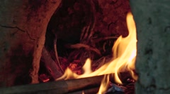 Fixing fire in a traditional stove. - stock footage