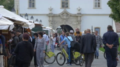 People walking and biking nearby souvenir stalls in the fortress of Alba Iulia Stock Footage