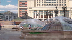 People having a rest on Manezh Square timelapse in Moscow. Moscow Hotel on Stock Footage