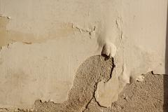 Effect of ascensional humidity on plaster finishing of old building Stock Photos