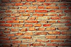 interesting red brick wall texture with vignette. for your design - stock photo