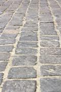 Stock Photo of stone tiles on pedestrian pathway, perspective view