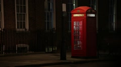 Red phone box in the night Stock Footage