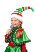 Girl - Santa's elf with a microphone. Stock Photos