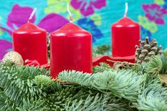 Advent wreath with red candles with green background, Christmas celebration, - stock photo