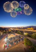 Beautiful fireworks under Arno River and Ponte Vecchio - stock photo