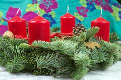 Advent wreath with red candles with green background, Christmas celebration - stock photo