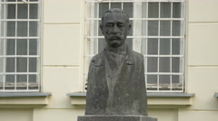 Torso statue of Alexandru Vaida Voievod in front of the Union Hall in Alba Iulia Stock Footage