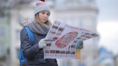 Tourists choose the direction on the map - stock footage