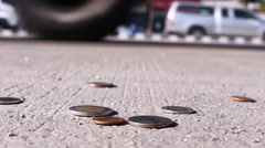 man collect coins on street - stock footage