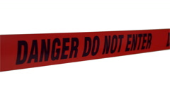 """Tape barrier """"danger, do not enter"""" in the wind on white screen.  Stock Footage"""